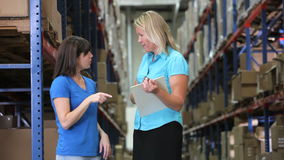 Manager And Worker Checking Goods In Warehouse stock video footage