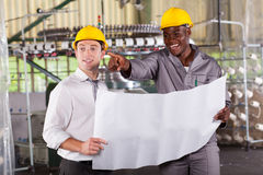 Manager worker discussing Stock Image