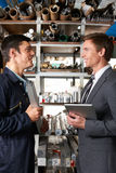Manager And Worker In Factory Store Room Royalty Free Stock Image