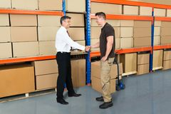 Manager And Worker Shaking Hands Stock Image