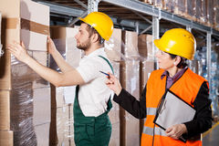 Manager with worker in warehouse Stock Image