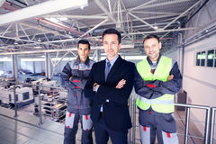 Manager and workers in factory Royalty Free Stock Photography