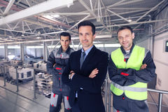 Manager and workers in factory Stock Photography