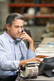 Manager Working At Desk In Warehouse Stock Images