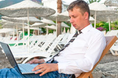 Manager working on a laptop Royalty Free Stock Image