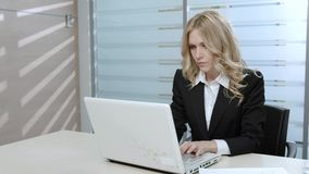 Manager works in the office. Business lady working at the computer. Girl at the workplace stock footage