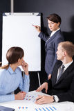 Manager writing on the board Stock Photo