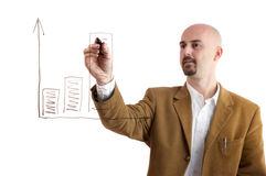 Manager writing chart. Young manager writing chart on board with white background Royalty Free Stock Photography