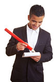 Manager writing with red pencil Royalty Free Stock Photography