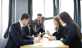Manager yelling at his employees at the meeting. Company is in recession. Royalty Free Stock Image