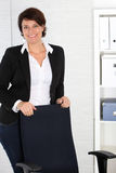 Manageress standing behind her chair Royalty Free Stock Photography