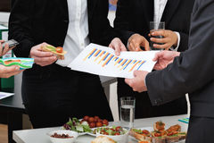 Managers at business lunch. Managers analyzing chart at a business lunch Royalty Free Stock Photography