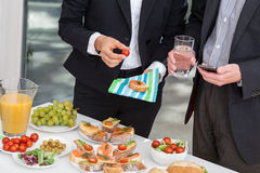 Managers at business lunch. Managers at office buffet during business lunch Royalty Free Stock Photos
