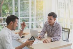 Managers and business teams are showing success. Two businessman royalty free stock image