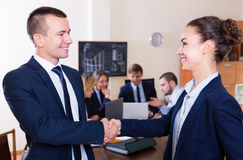 Managers closing deal with shaking hands Royalty Free Stock Photo