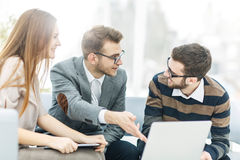 Managers of the company and the client, discussing the terms of the new contract and look at the laptop screen with the Royalty Free Stock Photography