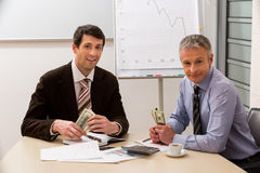 Managers earn the money. Royalty Free Stock Image