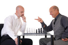Managers playing chess. Two managers playing chess on white background Stock Photos