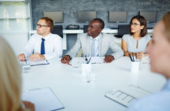 Managers at seminar. Young specialists listening to spokesperson at seminar Royalty Free Stock Photo