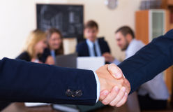 Managers shaking hands after successful deal Stock Photography