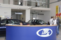 Managers in a show-room of car dealership Stock Photography