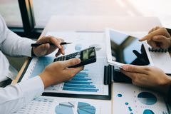 Managers are using tablets to analyze sales cost reports and explain summary reports to employees calculate and record summary stock photos