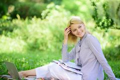 Managing business remote outdoors. Woman with laptop sit grass meadow. Best jobs to work remotely. Stay free with remote. Job. Business lady freelance work stock photos