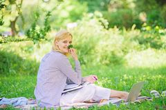 Managing business remote outdoors. Woman with laptop sit grass meadow. Best jobs to work remotely. Business lady. Freelance work outdoors. Remote job concept royalty free stock photo