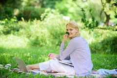 Managing business remote outdoors. Woman with laptop sit grass meadow. Best jobs to work remotely. Business lady. Freelance work outdoors. Remote job concept stock image