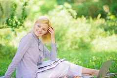 Managing business remote outdoors. Woman with laptop sit grass meadow. Best jobs to work remotely. Stay free with remote. Job. Business lady freelance work stock photography