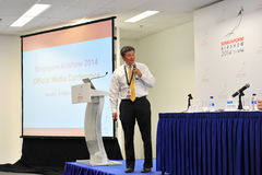 Managing Director of Experia Events speaking at media conference of Singapore Airshow Royalty Free Stock Image