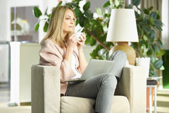 Managing her business from home Stock Images