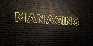 MANAGING -Realistic Neon Sign on Brick Wall background - 3D rendered royalty free stock image Stock Photo