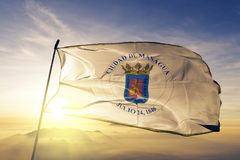 Managua Department of Nicaragua flag textile cloth fabric waving on the top sunrise mist fog. Beautiful stock image