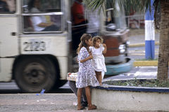 Managua street view, street children and city bus. Nicaragua, city Managua at a bus stop in the center of the capital hang around street children. These two Royalty Free Stock Images