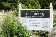 Close up image of the Welcome to Kuku Beach information sign, Manawatu, New Zealand. Manakau, New Zealand - February 27, 2016: Kuku Beach information board Royalty Free Stock Photography