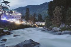 Manali by the river. Manali small village in the north of india by the river at the sunset royalty free stock image
