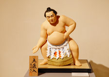 Dohyo-iri: Display of Sumo Wrestlers in the Ring. MANAMA, BAHRAIN - MARCH 01: The Dolls of Japan Exhibition on March 01, 2012 in Bahrain on the occasion of the stock illustration
