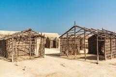 MANAMA, Bar?m - 19 de dezembro de 2018: ru?na do forte em Manama, Qal ?no museu do local de al-Bar?m, heran?a do UNESCO, de madei fotografia de stock