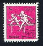 Hurdling at Olympics. MANAMA - CIRCA 1972: stamp printed by Manama, shows Hurdling at Olympics, circa 1972 Stock Image