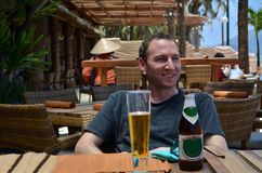 Manand beer. Man enjoying beer on a nice beach restaurant Stock Photo