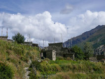 Manang and Annapurna 2 in the clouds, Nepal Royalty Free Stock Photo