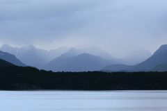 Manapouri Lake in the rain. Southland, South island,  New Zealand Royalty Free Stock Images