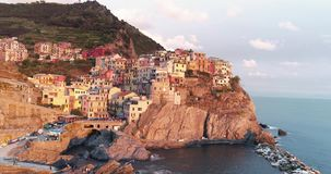 Manarola Aerial View. Amazing aerial view of Manarola village on cliff rocks and turquoise sea.Stunning view of beautiful and cozy town in Cinque Terre Reserve stock footage