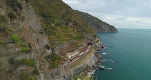Manarola Aerial View. Amazing aerial view of Manarola village on cliff rocks and turquoise sea.Stunning view of beautiful and cozy town in Cinque Terre Reserve stock video footage