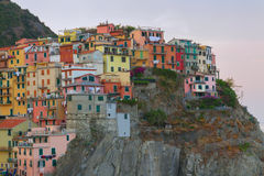 Manarola charming little fishing village at sunrise, colorful ho Stock Image