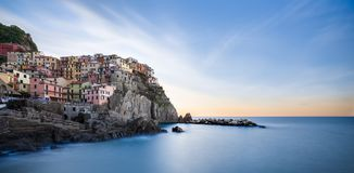 Manarola, Cinque Terre, Italy. View of Manarola at sunrise. Long exposure shoot Royalty Free Stock Images