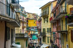 Manarola in Cinque Terre in Italy. Beach streets and colorful houses on the hill in Manarola in Cinque Terre in Italy stock photography