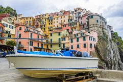 Manarola in Cinque Terre in Italy. Beach streets and colorful houses on the hill in Manarola in Cinque Terre in Italy royalty free stock image