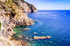 Manarola, Cinque Terre, Italy. Cinque Terre, Italy. Rocky coastline of Mediterranean Sea at province La Spezia, holiday place in Liguria Royalty Free Stock Photos